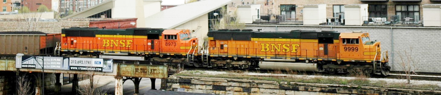 Chicago 16th St. - BNSF Engines 9999 & 8973 on former IC main line, tug on a consist of loaded coal hoppers