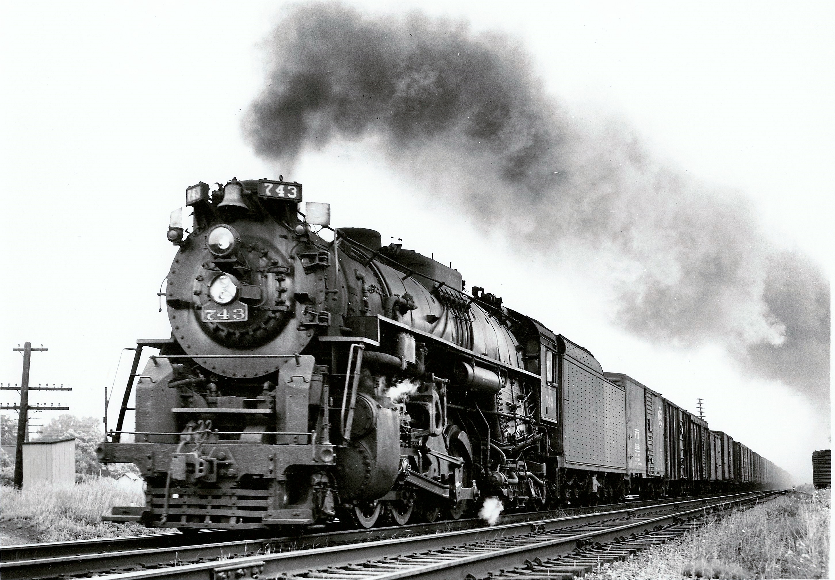 NKP engine No.743 (2-8-2) highballing with train consist